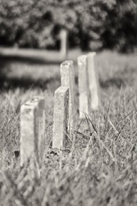 http://www.dreamstime.com/stock-photos-row-unmarked-small-child-headstones-vertical-black-white-image34299323