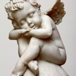 A sleeping angel figure isolated